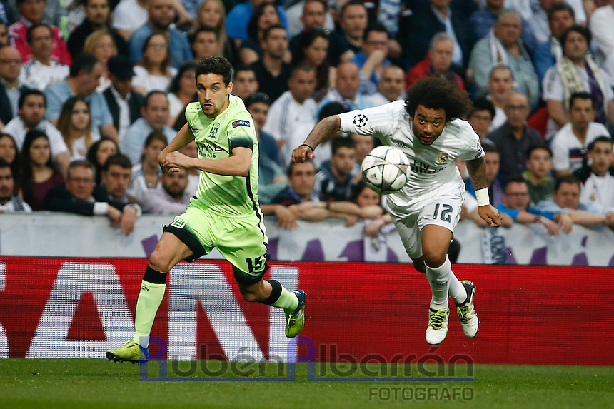 Real Madrid's Brazilian defense Marcelo and Manchester City´s midfielder  Jesus Navas during the UEFA Champions League match between Real Madrid and Manchester City at the Santiago Bernabeu Stadium in Madrid, Wednesday, May 4, 2016.