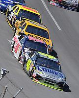 Apr 26, 2009; Talladega, AL, USA; NASCAR Sprint Cup Series driver Jimmie Johnson (48) leads teammate Dale Earnhardt Jr (88) during the Aarons 499 at Talladega Superspeedway. Mandatory Credit: Mark J. Rebilas-