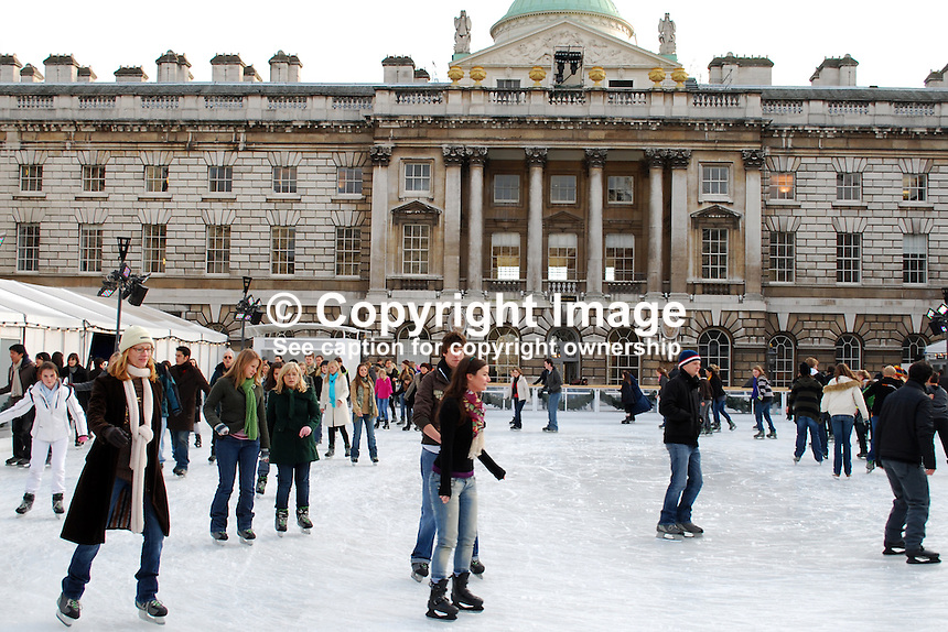Skaters skating on the temporary (Christmas & New Year) icerink in the courtyard at Somerset House, the Strand, London, UK, 200812051624..Copyright Image from Victor Patterson, 54 Dorchester Park, Belfast, UK, BT9 6RJ..Tel: +44 28 9066 1296.Mob: +44 7802 353836.Voicemail +44 20 8816 7153.Skype: victorpattersonbelfast.Email: victorpatterson@mac.com.Email: victorpatterson@ireland.com (back-up)..IMPORTANT: If you wish to use this image or any other of my images please go to www.victorpatterson.com and click on the Terms & Conditions. Then contact me by email or phone with the reference number(s) of the image(s) concerned.