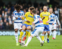 Leeds United's Tyler Roberts competing with Queens Park Rangers' Josh Scowen<br /> <br /> Photographer Andrew Kearns/CameraSport<br /> <br /> The Emirates FA Cup Third Round - Queens Park Rangers v Leeds United - Sunday 6th January 2019 - Loftus Road - London<br />  <br /> World Copyright &copy; 2019 CameraSport. All rights reserved. 43 Linden Ave. Countesthorpe. Leicester. England. LE8 5PG - Tel: +44 (0) 116 277 4147 - admin@camerasport.com - www.camerasport.com