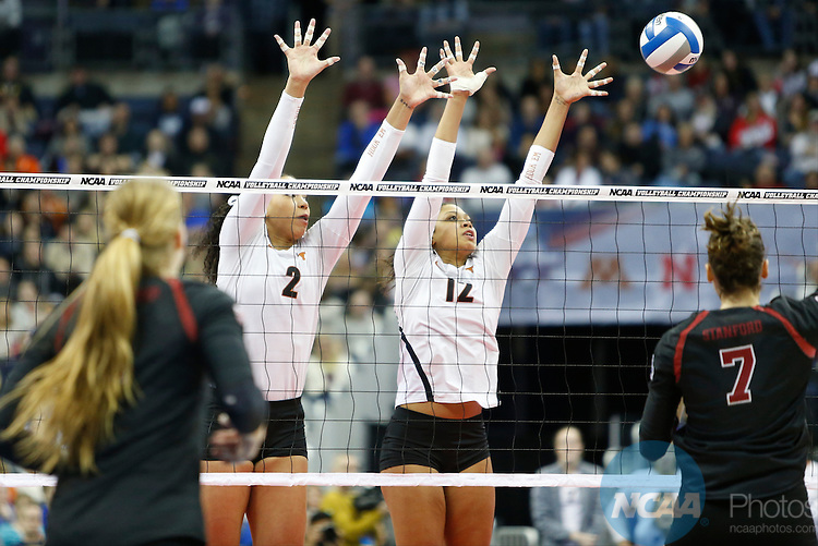 COLUMBUS, OH - DECEMBER 17:  Ebony Nwanebu (2) and Morgan Johnson (12) of the University of Texas jump for a block against Stanford University during the Division I Women's Volleyball Championship held at Nationwide Arena on December 17, 2016 in Columbus, Ohio.  Stanford beat Texas 3-1 to win the national title.  (Photo by Jay LaPrete/NCAA Photos via Getty Images)