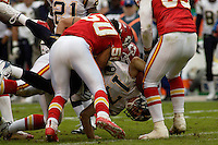 Chiefs tackle Ron Edwards (back) and linebacker Kawika Mitchell (50) turn San Diego Chargers quarterback Philip Rivers upside down for a sack during the third quarter at Arrowhead Stadium  in Kansas City, MO on October 22, 2006. The Chiefs won 30-27.