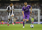 June 3rd 2017, National Stadium of Wales , Wales; UEFA Champions League Final, Juventus FC versus Real Madrid;  Karim Benzema of Real Madrid dribbles past Dani Alves of Juventus