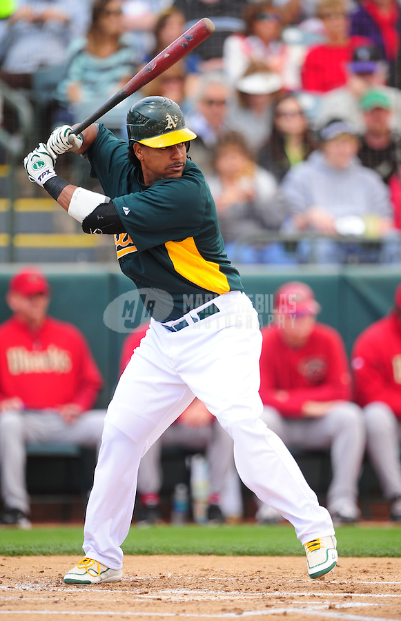 Mar. 19, 2012; Phoenix, AZ, USA; Oakland Athletics designated hitter Manny Ramirez bats in the first inning against the Arizona Diamondbacks during a spring training game at Phoenix Municipal Stadium.  Mandatory Credit: Mark J. Rebilas-
