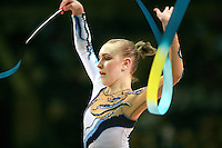 """Stephanie Sandler of South Africa waves with ribbon at 2007 World Cup Kiev, """"Deriugina Cup"""" in Kiev, Ukraine on March 17, 2007."""