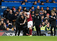 11th January 2020; Stamford Bridge, London, England; English Premier League Football, Chelsea versus Burnley; Chris Wood of Burnley is treated on the touchline by the Burnley medcial team for a noise bleed by the Burnley medical team - Strictly Editorial Use Only. No use with unauthorized audio, video, data, fixture lists, club/league logos or 'live' services. Online in-match use limited to 120 images, no video emulation. No use in betting, games or single club/league/player publications