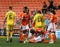 Blackpool's Armand Gnanduillet checks on team-mate Matty Virtue after he lies injured after a tackle by Fleetwood Town's Nathan Sheron which resulted in a red card for the offender<br /> <br /> Photographer Stephen White/CameraSport<br /> <br /> The EFL Sky Bet League One - Blackpool v Fleetwood Town - Monday 22nd April 2019 - Bloomfield Road - Blackpool<br /> <br /> World Copyright © 2019 CameraSport. All rights reserved. 43 Linden Ave. Countesthorpe. Leicester. England. LE8 5PG - Tel: +44 (0) 116 277 4147 - admin@camerasport.com - www.camerasport.com