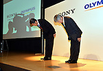 October 1, 2012, Tokyo, Japan - Kazuo Hirai, left, CEO of Sony Corp., and  President Hiroyuki Sasa of Olympus Corp. pose for photographers following a news conference in Tokyo on Monday, October 1, 2012, following the announcement of its tie-up with the scandal stricken Olympus Corp. ..Sony and Olympus have concluded a capital and business tie-up agreement to shore up the scandal-hit Japanese medical equipment and camera maker, and will set up a joint firm to expand their medical operations. With the alliance, Sony will become Olympus' leading shareholder by acquiring a stake of around 11 percent with investment of about 50 billion yen, aiming to expand its medical business as an area of potential growth.  (Photo by Natsuki Sakai/AFLO) AYF -mis-