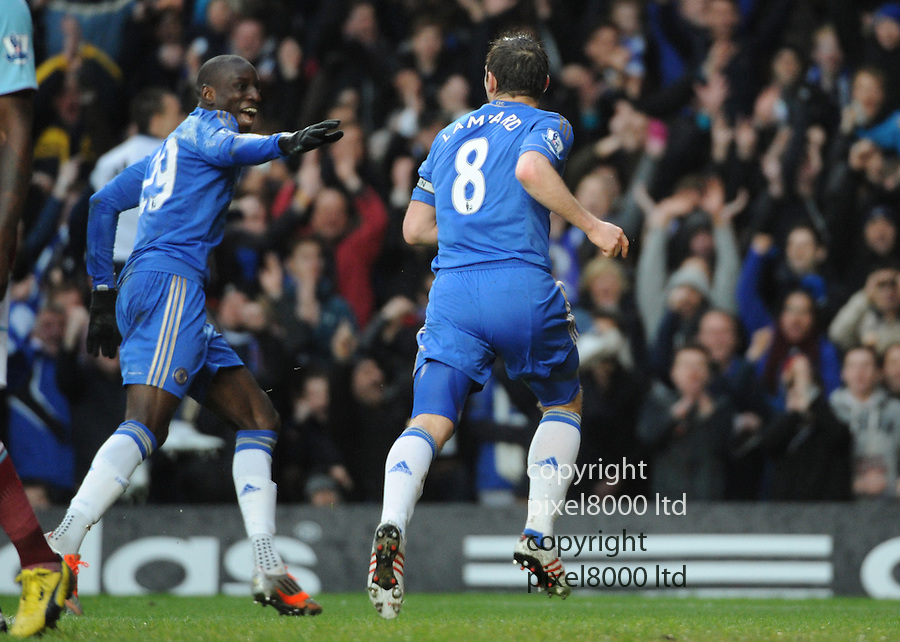 Frank Lampard and Demba Ba celebrate a goal with teams and fans during the Barclays Premiere League match between Chelsea and West Ham United at Stamford Bridge on Sunday March 17, 2013 in London, England Picture Zed Jameson/pixel 8000 ltd.