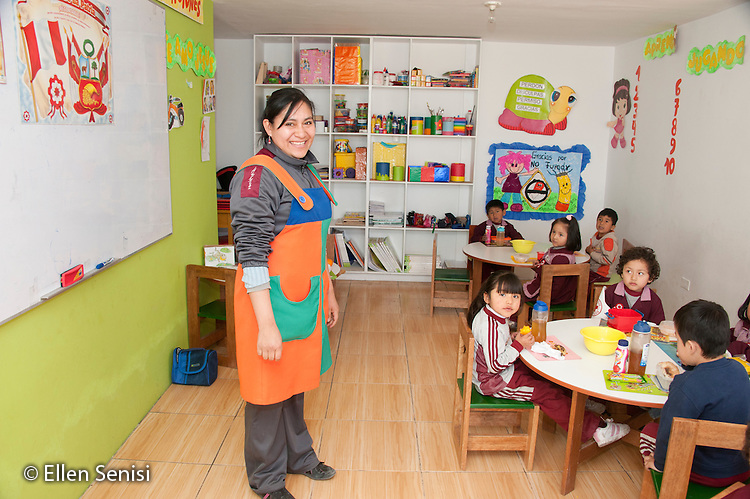 Arequipa, Peru. Hefziba, a parochial (Christian), private school for elementary and secondary school students. Teacher (Peruvian) with her class of students (pre-school aged, Peruvian) in primary school classroom. No MR. ID: AL-peru.