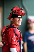 Catcher Samuel Miranda (21) of the Greenville Drive waits in the dugout before a game against the Rome Braves on Saturday, April 14, 2018, at Fluor Field at the West End in Greenville, South Carolina. Rome won, 4-0. (Tom Priddy/Four Seam Images)