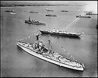 BNPS.co.uk (01202 558833)<br /> Pic: Aerofilms/HistoricEngland/BNPS<br /> <br /> The Royal Yacht HMY Victoria &amp; Albert at Spithead Review, July 1924.<br /> <br /> Stunning historic aerial photos of seaside towns, naval bases, ports and shipyards which tell the story of Britain's once-great maritime tradition feature in a new book.<br /> <br /> The fascinating archive of black and white images includes views from a bygone age such as Brighton's famous West Pier, Grimsby's burgeoning fishing fleet, and London's dock yards.<br /> <br /> Iconic ships were also captured from the skies including the Cutty Sark in its final seaworthy years on the Thames, HMY Britannia in 1959, the RMS Queen Mary in 1946 and the SS Queen Elizabeth in 1969 about to make her maiden voyage.<br /> <br /> England's Maritime Heritage from the Air, by Peter Waller, is published by English Heritage and costs &pound;35.