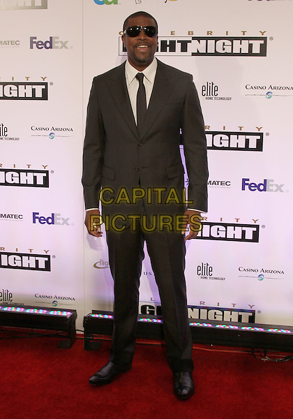 CHRIS TUCKER.Celebrity Fight Night 2010 held at the Marriott Desert Ridge Resort and Spa, Phoenix, Arizona, USA..March 20th, 2010.full length black suit tie sunglasses brown shades goatee facial hair .CAP/ADM/DC.©Darrylee Cohen/AdMedia/Capital Pictures.
