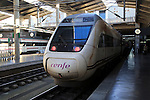 RENFE Alvia train at platform of railway station, Cordoba, Spain