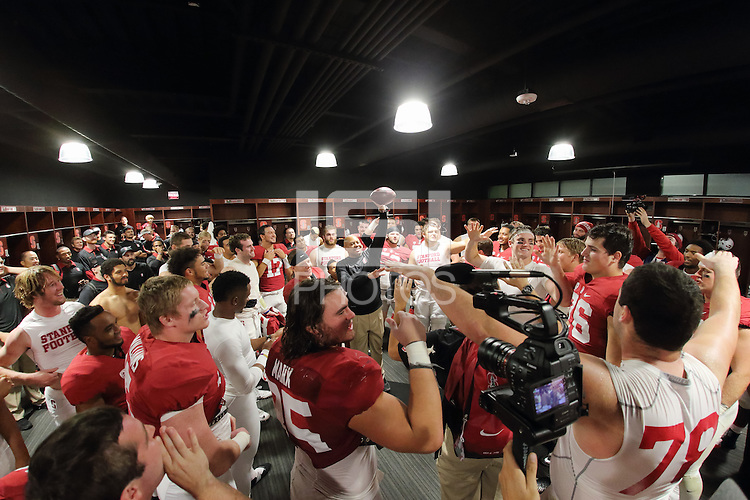 Stanford, CA -- October 15, 2015:  Stanford vs UCLA at Stanford Stadium.   Stanford won 56-35.  Head Coach David Shaw awards the game ball to Christian McCaffrey (5).