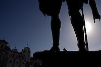 Silhouetted statue of Guanche warrior looking over the Candelaria Cathedral, Tenerife, Canary Islands.