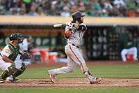OAKLAND, CA - JULY 21:  Brandon Crawford #35 of the San Francisco Giants bats against the Oakland Athletics during the game at the Oakland Coliseum on Saturday, July 21, 2018 in Oakland, California. (Photo by Brad Mangin)
