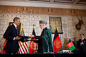 United States President Barack Obama and President Hamid Karzai of Afghanistan exchange documents after signing the strategic partnership agreement signing ceremony at the Presidential Palace in Kabul, Afghanistan, May 1, 2012. .Mandatory Credit: Pete Souza - White House via CNP
