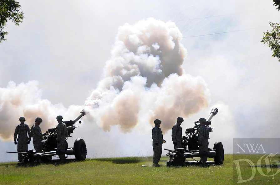 "NWA Media/ J.T. Wampler - A gun crew fires a salute in honor of Col. Gregory ""Greg"" C. Bacon of Conway who assumed command of the 142nd Field Artillery Bridgade from outgoing commander Col. Troy D. Galloway during a change of command ceremony Saturday Oct. 4, 2014."