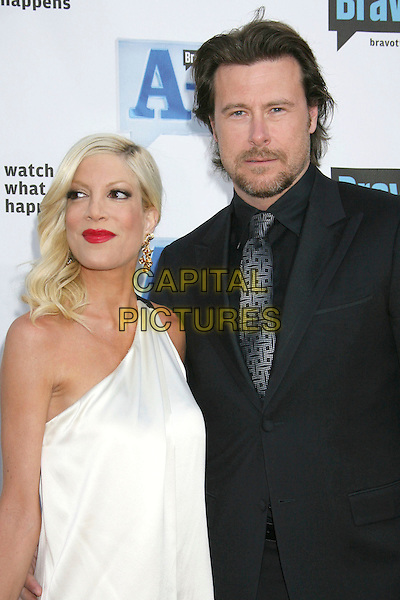 "TORI SPELLING & DEAN McDERMOTT .Bravo's 2nd Annual ""The A-List Awards"" held at The Orpheum Theatre, Los Angeles, CA, USA, 5th April 2009..half length one shoulder cream white dress red lipstick black suit husband wife .CAP/ADM/MJ.©Michael Jade/Admedia/Capital Pictures"