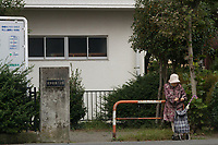 An older Japanese woman with a wheely bag shooping basjet in the street near Sagami Ono , Kanagawa, Japan. Sunday September 30th 2018
