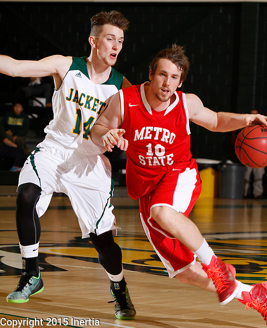 JANUARY 31, 2015 -- Mitch McCarron #10 of Metro State drives past Ryan Miller #14 of Black Hills State during their Rocky Mountain Athletic Conference men's basketball game Saturday evening at the Donald E. Young Center in Spearfish, S.D.  (Photo by Dick Carlson/Inertia)