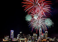 Fireworks explode over the Charlotte NC skyline as the city celebrated the July 4th holiday in 2012. Photographer has fireworks celebrations in Charlotte from multiple years. The collection of Charlotte NC fireworks photos show different perspectives and weather conditions.