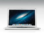 Apple Macbook Pro laptop computer front view with desktop on its display isolated on white background with clipping path