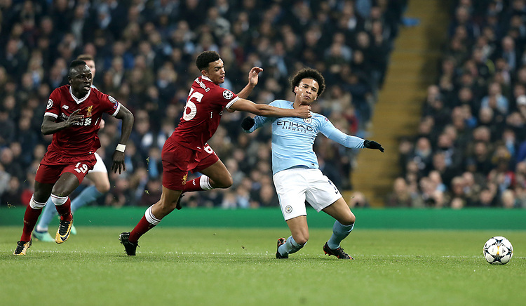 Manchester City's Leroy Sane goes down under the challenge from Liverpool's Trent Alexander-Arnold who received a Yellow Card for the offence<br /> <br /> Photographer Rich Linley/CameraSport<br /> <br /> UEFA Champions League Quarter-Final Second Leg - Manchester City v Liverpool - Tuesday 10th April 2018 - The Etihad - Manchester<br />  <br /> World Copyright &copy; 2017 CameraSport. All rights reserved. 43 Linden Ave. Countesthorpe. Leicester. England. LE8 5PG - Tel: +44 (0) 116 277 4147 - admin@camerasport.com - www.camerasport.com