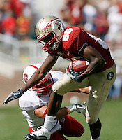 TALLAHASSEE, FL 10/31/09-FSU-NCST FB09 CH39-Florida State's Beau Reliford gets by N.C. State's Brandan Bishop  during second half action Saturday at Doak Campbell Stadium in Tallahassee. The Seminoles beat the Wolf Pack 45-42..COLIN HACKLEY PHOTO