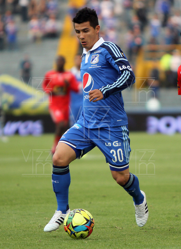 BOGOTA -COLOMBIA. 29-03-2014. Omar Vasquez  de Millonarios  en accion contra  Patriotas de Boyaca F.C.  partido por la treceava  fecha de La liga Postobon 1 disputado en el estadio Nemesio Camacho El Campin. / Omar Vasquez  of Millonarios  in actions against  of Patriotas de Boyaca F.C.   during the match for the thirteenth round of The Postobon one league match at Nemesio Camacho El Campin  Stadium . Photo: VizzorImage/ Felipe Caicedo / Staff