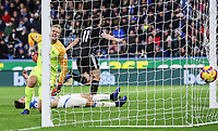 Burnley's Chris Wood reels away in celebration as Huddersfield Town's goalkeeper Jonas Lossl despairs<br />