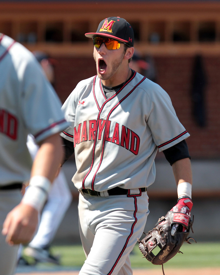 Maryland shortstop Blake Schmit (1) celebrates the 5-4 win over Virginia after the NCAA college baseball tournament super regional game in Charlottesville, Va., Saturday, June 7, 2014. Maryland defeated Virginia 5-4. (AP Photo/Andrew Shurtleff)