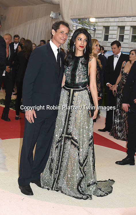 Anthony Weiner and wife Hama Ubedin attends the Metropolitan Museum of Art Costume Institute Benefit Gala on May 2, 2016 in New York, New York, USA. The show is Manus x Machina: Fashion in an Age of Technology. <br /> <br /> photo by Robin Platzer/Twin Images<br />  <br /> phone number 212-935-0770