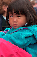 Asian girl age 3 looking serious at Vietnam Wall on Memorial Day.  St Paul  Minnesota USA