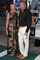 "WESTWOOD, LOS ANGELES, CA, USA - APRIL 07: Christine Baumgartner and Kevin Costner arrive at the Los Angeles Premiere Of Summit Entertainment's ""Draft Day"" held at the Regency Bruin Theatre on April 7, 2014 in Westwood, Los Angeles, California, United States. (Photo by Xavier Collin/Celebrity Monitor)"
