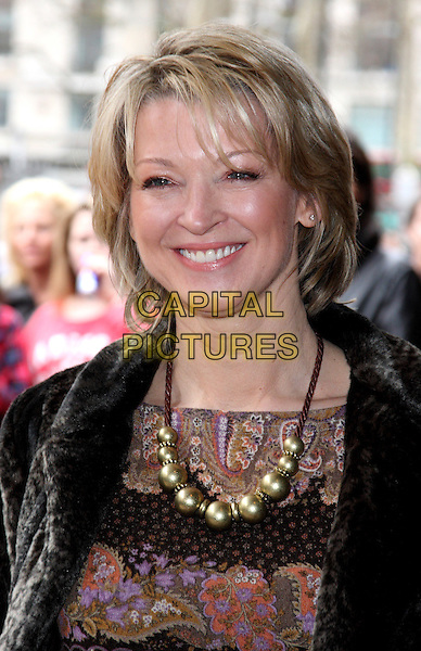 GILLIAN TAYLFORTH.Celebrity Screening of 'How to Train Your Dragon' at the Vue West End, Leicester Square, London, USA..March 28th 2010.headshot portrait black necklace gold paisley smiling .CAP/JIL.©Jill Mayhew/Capital Pictures