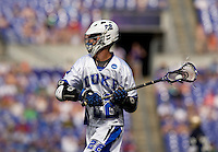 Ned Crotty (22) of Duke looks for a teammate during the NCAA Men's Lacrosse Championship held at M&T Stadium in Baltimore, MD.  Duke defeated Notre Dame, 6-5, to win the title in overtime.