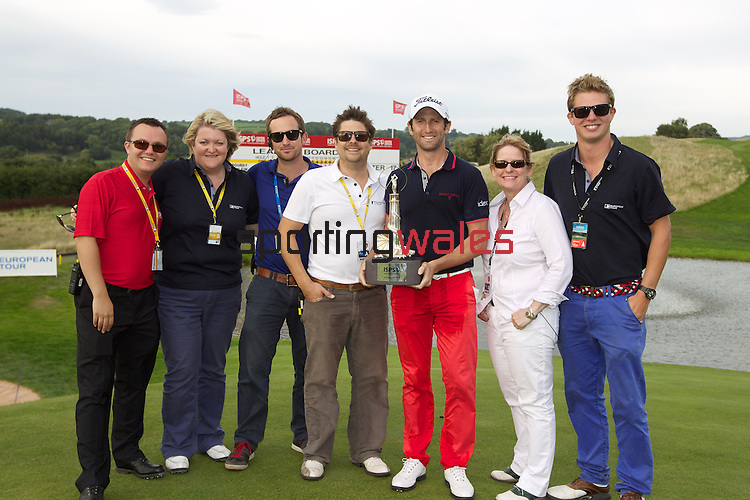 ISPS Handa Wales Open 2013<br /> Celtic Manor Resort<br /> Gregory Bourdy with event staff.<br /> 01.09.13<br /> <br /> &copy;Steve Pope-Sportingwales