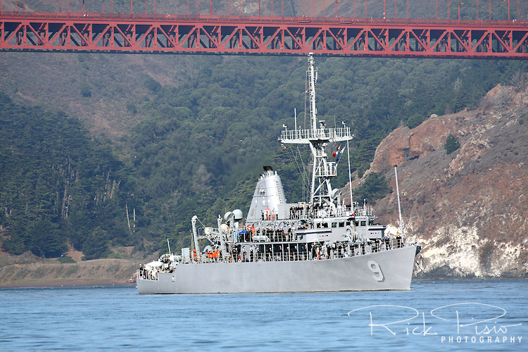 Mine Countermeasure ship USS Pioneer (MCM 9) passes under the Golden Gate Bridge as it enters San Francisco Bay. The Pioneer was participating the in the Parade Of Ships as part of San Francisco's 2010 Fleet Week activities. The USS Pioneer is the ninth Avenger class Mine Countermeasures Ship, the second ship in the Navy to bear the name, and is currently part of the Naval Reserve Force.