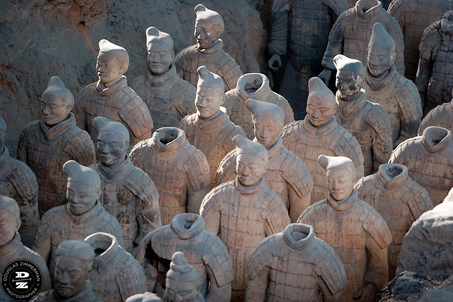The Terracotta Warriors located outside Xian, China.  The terracotta figures, dating from 210 BC, were discovered in 1974 by some local farmers near Xian, China near the Mausoleum of the First Qin Emperor. Photograph by Douglas ZImmerman
