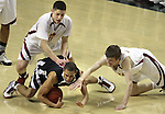Lincoln's J.D. Esters dives on the ball as Central Catholic's Victor Aguero and David Carr pursue in the Cardinals' 59-50 win over the Rams in the semifinals of the 6A state boys championship at McArthur Court Friday, March 13, 2009.