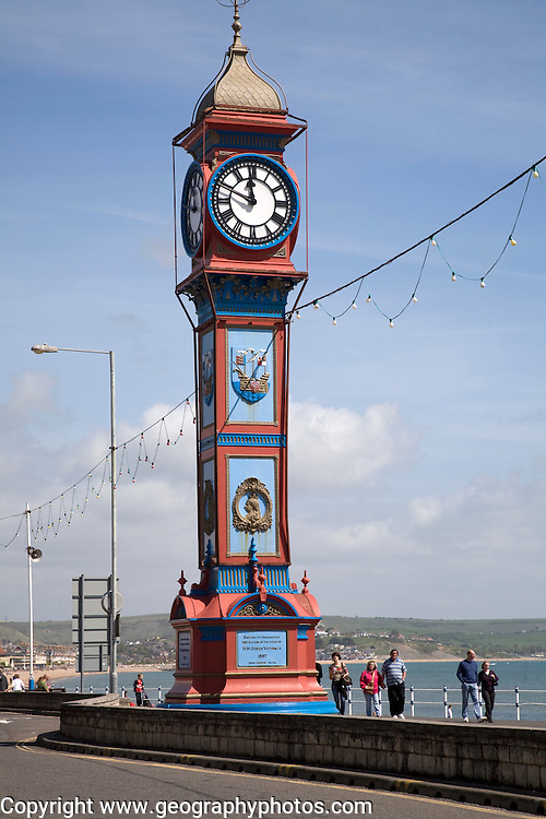 The Jubilee Clock tower Weymouth Dorset England. Th clock tower was built in 1887 marking the Golden Jubilee  of reign by Queen Victoria.  The Jubilee Clock tower is now one of the iconic symbols of Weymouth. It was re-located from its original location on the beach to the Esplanade in the 1920s.