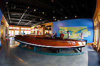 "The Antique Boat Museum: the gold cupper ""Baby Watercar"" on display in the entry hall."