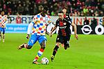 der Mainzer Moussa Niakhate am Ball mit dem Leverkusener Karim Bellarabi beim Spiel in der Fussball Bundesliga, 1. FSV Mainz 05 - Bayer 04 Leverkusen (dunkel).<br /> <br /> Foto &copy; PIX-Sportfotos *** Foto ist honorarpflichtig! *** Auf Anfrage in hoeherer Qualitaet/Aufloesung. Belegexemplar erbeten. Veroeffentlichung ausschliesslich fuer journalistisch-publizistische Zwecke. For editorial use only. DFL regulations prohibit any use of photographs as image sequences and/or quasi-video.