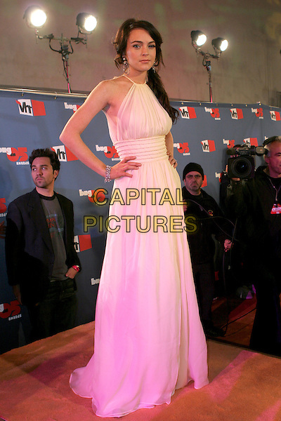 "LINDSAY LOHAN.""VH1 Big In '05 Awards"" - Arrivals held at Sony Studios, Culver City, California..December 3rd, 2005.Photo: Zach Lipp/AdMedia/Capital Pictures.Ref: ZL/ADM.full length white dress hand on hip halterneck.www.capitalpictures.com.sales@capitalpictures.com.© Capital Pictures."
