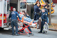 First responders stabilize and remove an accident victim in the Chelsea neighborhood of New York on Wednesday, November 12, 2014. (© Richard B. Levine)