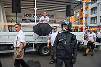 """Ueber 1.000 Rechtsextreme aus mehreren Bundeslaendern demonstrieren am Samstag den 19. August 2017 in Berlin zum Gedenken an den Hitler-Stellvertreter Rudolf Hess.<br /> Rudolf Hess hatte am 17. August 1987 im Alliierten Kriegsverbrechergefaengnis in Berlin Spandau Selbstmord begangen. Seitdem marschieren Rechtsextremisten am Wochenende nach dem Todestag mit sog. """"Hess-Maerschen"""".<br /> Weit ueber 1.000 Menschen protestierten gegen den Aufmarsch der Rechtsextremisten und stoppten den Hess-Marsch nach 300 Metern u.a. mit Sitzblockaden. Der rechtsextreme Aufmarsch wurde daraufhin von der Polizei umgeleitet.<br /> Aus dem Aufmarsch wurden mehrfach Gegendemonstranten angegriffen, mindestens ein Neonazi wurde festgenommen.<br /> Im Bild: Auf dem LKW der Versammlungsleiter Sebastian Schmidtke, NPD, aus Berlin.<br /> Vorne links: Lutz Giesen.<br /> 19.8.2017, Berlin<br /> Copyright: Christian-Ditsch.de<br /> [Inhaltsveraendernde Manipulation des Fotos nur nach ausdruecklicher Genehmigung des Fotografen. Vereinbarungen ueber Abtretung von Persoenlichkeitsrechten/Model Release der abgebildeten Person/Personen liegen nicht vor. NO MODEL RELEASE! Nur fuer Redaktionelle Zwecke. Don't publish without copyright Christian-Ditsch.de, Veroeffentlichung nur mit Fotografennennung, sowie gegen Honorar, MwSt. und Beleg. Konto: I N G - D i B a, IBAN DE58500105175400192269, BIC INGDDEFFXXX, Kontakt: post@christian-ditsch.de<br /> Bei der Bearbeitung der Dateiinformationen darf die Urheberkennzeichnung in den EXIF- und  IPTC-Daten nicht entfernt werden, diese sind in digitalen Medien nach §95c UrhG rechtlich geschuetzt. Der Urhebervermerk wird gemaess §13 UrhG verlangt.]"""