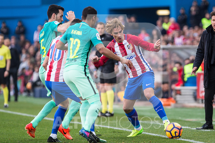 Yannick Ferreira Carrasco, Antoine Griezmann of Atletico de Madrid competes for the ball with Sergi Roberto and Rafinha Alcantara of Futbol Club Barcelona during the match of Spanish La Liga between Atletico de Madrid and Futbol Club Barcelona at Vicente Calderon Stadium in Madrid, Spain. February 26, 2017. (ALTERPHOTOS)
