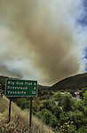August 20, 2001 Coulterville, California  -- Creek Fire –  View of fire behind Hetch Hetchy Reservoir at Moccasin. The Creek Fire burned 11,500 acres between Highway 49 and Priest-Coulterville Road a few miles north of Coulterville, California.